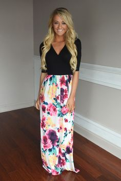 This gorgeous dress features a solid black v-neck top w/a vibrant floral bottom.  True to size. Model is 5'5'' a...