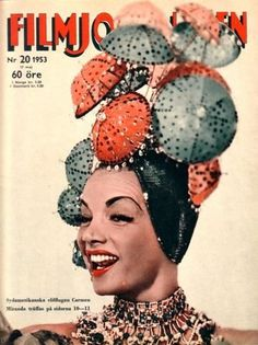 Carmen Miranda sang and danced either barefoot or in sandals, wearing wildly colorful costumes that included enormous head-dresses that often were composed of fruit –  that image   was the inspiration for Chiquita Banana, the cartoon character created by Dik Browne as the logo for a banana company.