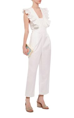 This **Tibi** jumpsuit features feminine shoulder ruffles and an open cross back.