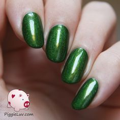 Gothic Gala Lacquers - Lili St. Cyr, from the Burlesque Girls collection. Deep, deep love. A gorgeous deep grassy green with holographic written all over her precious face.