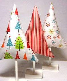 Pinterest Christmas Decorated Rooms | No-frills fabric stuffed tree forms perched on dowel trunks are kid ...