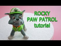 how to make rocky paw patrol cake topper fondant - tutorial cane in pasta di… Paw Patrol Rocky, Rubble Paw Patrol Cake, Torta Paw Patrol, Paw Patrol Cake Toppers, Paw Patrol Birthday Cake, Paw Patrol Party, Cake Topper Tutorial, Fondant Tutorial, Fondant Cake Toppers