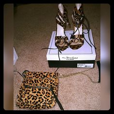 Leopard Steve Madden crossbody bag & Heels!!!! Matching Leopard Steve Madden crossbody bag and Tie up heels size 9 1/2, ties are black leather worn once. Price for both... Steve Madden Shoes Heels