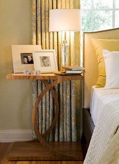 A curvaceous bedside table made of sustainable resources introduces warm wood to the bedroom's scheme - Traditional Home®
