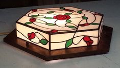 Custom Craftsman Ceiling Light by Mission Studio. This artistic handmade fixture features Quartersawn Oak with handrolled and custom cut stain glass. The picture shows the piece on a table top but as a light fixture it will mount flush to the ceiling. Craftsman Lighting, Stained Glass Rose, Rose Vines, Picture Show, Colored Glass, A Table, Light Fixtures, Glass Art, Decorative Boxes