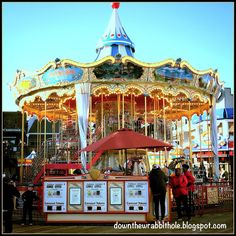 """Ride the two level carousel on Pier 39 at San Francisco's Fisherman's Wharf. Find out more at """"Down the Wrabbit Hole - The Travel Bucket List"""". Click the image for the blog post."""