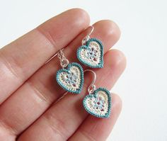 With each heart measuring just 1cm across, this pair of earrings are incredibly light and dainty. Three different coloured cottons were used for this design, crocheted by hand and teamed with sterling silver ear wires. Also available are matching pendants. Other colours available upon