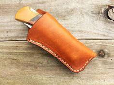 "RK LeatherWorks KNIFE NOT FOR SALE Up for your consideration a custom hand tooled leather knife sheath for a Buck 110/112. This sheath measures 4 6/8 x 2 1/2 with a 1 7/8"" opening. The sheath is 8/9 oz heavy duty leather with the welt stitched to ensure its secure. This leather may or may not have range marks, which in my opinion adds character to the sheath. For brown sheaths I only use Fiebings Professional Oil Dye in Dark Brown but due to the natural pigment in t..."