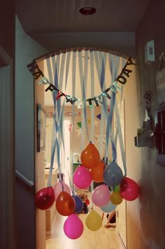 upside-down balloons - perfect to have as a surprise for the birthday kid leading into the kitchen!