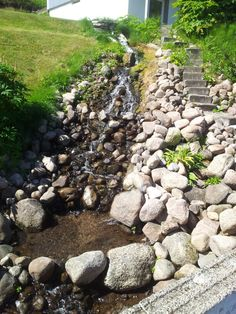 Found this when I were walking. A natural waterfall in The garden. It would be lovley...