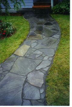 A new Bluestone walkway and front deck. design by Dave Kelly , Installation by Everything Outdoors Landscape & Construction LLC.   WWW.eolcllc.com