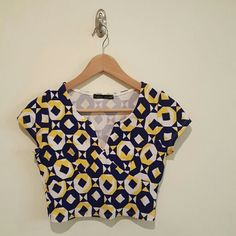 Patterned crop top Blue, yellow, and white crop top. Perfect for music festivals!! Fashion Dazzle  Tops Crop Tops