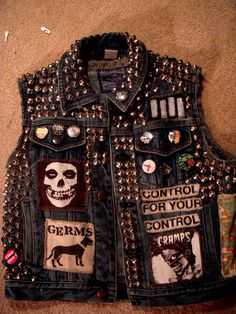 Heather's personal vest. You can smell the whiskey through the computer...#punk #patches # vest