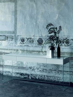 Float glass console table by Glas Italia. Shown with extra clear glass leg structure and white glass drawer unit.