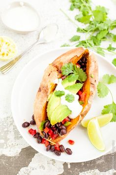 These loaded sweet potatoes are baked and stuffed with a spiced black bean filling.