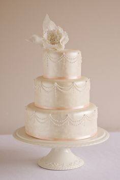 Lustre and piped wedding cake  Www.cakesbysophiepage.co.uk