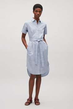 This shirt dress is made from soft cotton with a satin feel, twill finish. A belted style, it has a hidden front placket, simple in-seam pockets and short, folded sleeves.