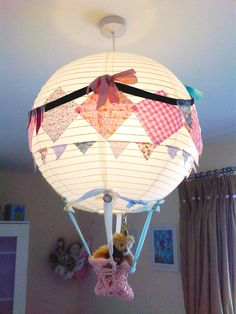 Customise a paper lantern from IKEA with fabric swatches.