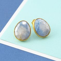 With their luscious aqua hues, these stunning handmade organic stud earrings feature soft azure sapphire slices set into sterling silver 18k gold vermeil. #Embersjewellery #Jewellery #accessories #giftforher #Sapphire #Blue