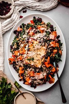 Roasted feta becomes deliciously creamy & melty. It's especially delicious when you toss it with roasted sweet potatoes, farro and kale.