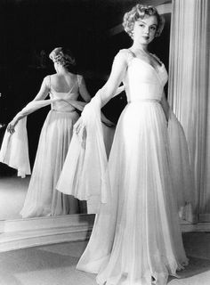 Ohhhhhh, that dress! Marilyn Monroe models for Saks Fifth Avenue