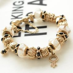 PANDORA Golden Bracelet with Beautiful Murano and Select Gold Charms!