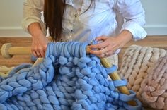 The love of giant knitting - knit yourself a blanket in just 45 minutes  http://www.woolcouturecompany.com/product-category/blankets/  #knit #knitting #blanket #giant #needles