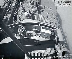 Scrapbook of Sixth War Patrol Wahoo: Mare Island Naval Shipyard - From Forest Sterling's lookout perch, changes to Wahoo's bridge can be seen. From the left is the voice tube, T.B.T., gyrocompass repeater, diving alarm, rudder angle indicator and speaker-microphone. A four-inch gun has been mounted forward of the fairwater. Courtesy Steve Reichmuth, Tom Anderson & Jack Kocher.