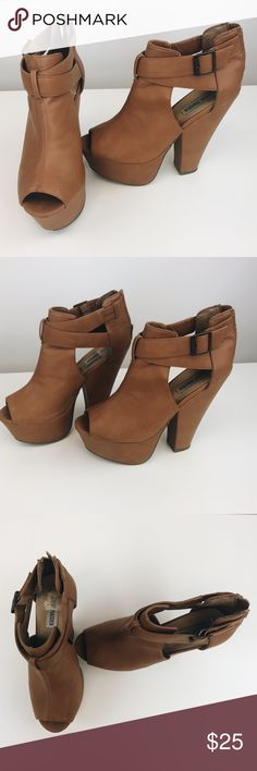 Steve Madden heels Carmel brown 1-2 inch heels with only some scrapes and scuffs on the back of the heel Steve Madden Shoes