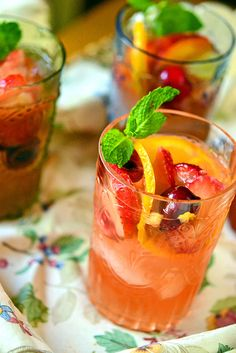White Sangria aka Pink Sangria - fruity white wine (like pinot grigio or sauvignon blanc), orange liqueur, peaches, strawberries, oranges, green grapes, bing cherries, simple syrup, and fresh mint sprigs for garnish