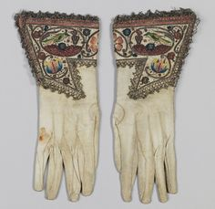 Pair of gloves,1620–40. British or Dutch. The Metropolitan Museum of Art, New York. Gift of Mrs. Edward S. Harkness, 1928 (28.220.3,.4) | The gauntlets on this pair of gloves contain small birds and flaming hearts, surely symbols of romantic devotion.