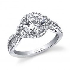 This unique diamond engagement ring features a 2.00 carat round brilliant center diamond with a total of 0.33 carats of round diamonds in our signature halo and a beautiful twisted shank.