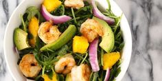 Sweet mango, peppery arugula, and creamy avocado combine to make a delicious salad.
