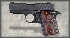 Sig Sauer P938 Rosewood - What a beauty! This will hopefully one day be my primary carry wrap of choice... That rosewood would look nice with a grey or brown suit :)