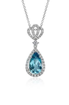This beautiful drop pendant showcases an exceptional pear-shaped aquamarine gemstone suspended from a delicate crown of brilliant diamonds.