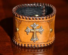 Endearing Cross Laced Leather Cuff.  Hand by EncoreLeatherDesigns, $145.00