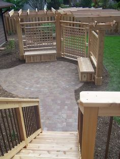 Walk off your new deck onto a beautiful paver patio complete with a privacy pergola.  Custom benches were added for extra outdoor storage and seating.