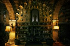 Wine Cellar Bottles - Part of the wine cellar in of Els Calderers, a 18th-century mansion on Majorca, Spain.