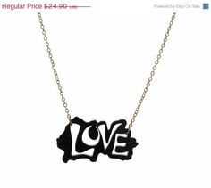 """This Beautiful necklace features a 1.77"""" (4.5 cm) love pendant made of black acrylic. It comes on a gold plated Cable chain.    The chain is approx.16.9"""" (43 cm) long.    A chic look for any occasion.    All of my jewelry comes with a gift box.   Price: $19.9"""
