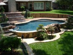 On ground pool in sloped yard with deck