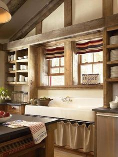 giant farm sink and rustic shelving