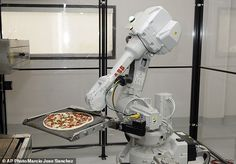 """#DailyMailUK ... """"Zume is one of a growing number of food-tech firms seeking to disrupt the restaurant industry with software and robots. The startup will soon add robots to prep the dough, add cheese and toppings, take pizzas out of the oven, cut them into slices and box them for delivery."""".... http://www.dailymail.co.uk/sciencetech/article-3788559/Hungry-startup-uses-robots-grab-slice-pizza.html"""