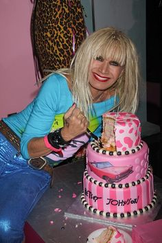 Betsey Johnson. . .she's amazing.. . and still does cart wheels on stage!