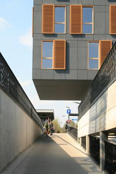 Abscis Architecten - The architecture consists of slick fiber cement boards combined with warm wooden windows and mobile solar protection - photography Abscis Architects