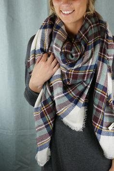 This oversized plaid blanket scarf with frayed edges is available in two colors: teal and mustard. These scarves are so cozy and add the perfect touch to any outfit. Size: 58 X 58 100% Acrylic