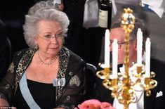 Princess Christina of Sweden  wearing the Five Button Tiara- the elder sister of King Carl - is pictured at the 'honor table' during the Nobel banquet. The centre table is reserved for royalty and other VIP guests