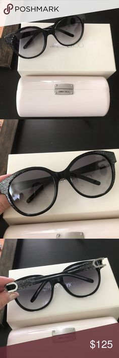 Jimmy Choo black with silver glitter sunglasses Authentic jimmy Choo black sunglasses with silver glitter detail on frame and silver hardware on the legs glass frame fades from darker to lighter. Some links scratches. Comes with box , case and cloth cleaner Jimmy Choo Accessories Sunglasses
