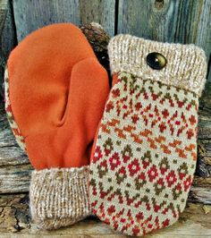 Bright patterned sweater wool was used to make this attractive pair of attractive wool mittens. The palm is bright orange and cuff is a variegated orange knit sweater. They are lined with black fleece and have a large brown button detail. Sweater Mittens, School Sets, Orange Pattern, Teaching Art, Hand Sewing, Upcycle, Winter Hats, Wool, Trending Outfits