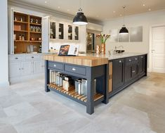 This black and grey kitchen features statement island with integrated oak chopping block and bespoke kitchen dresser for all your kitchen storage needs. Black And Grey Kitchen, Grey Painted Kitchen, Kitchen Paint, Home Decor Kitchen, Kitchen Living, Rustic Kitchen, Kitchen Interior, New Kitchen, Awesome Kitchen