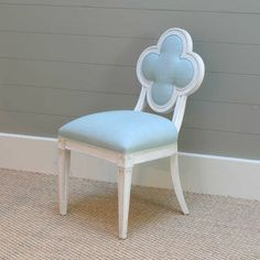 Suzanne Kasler's chair-love the clover inspired back!